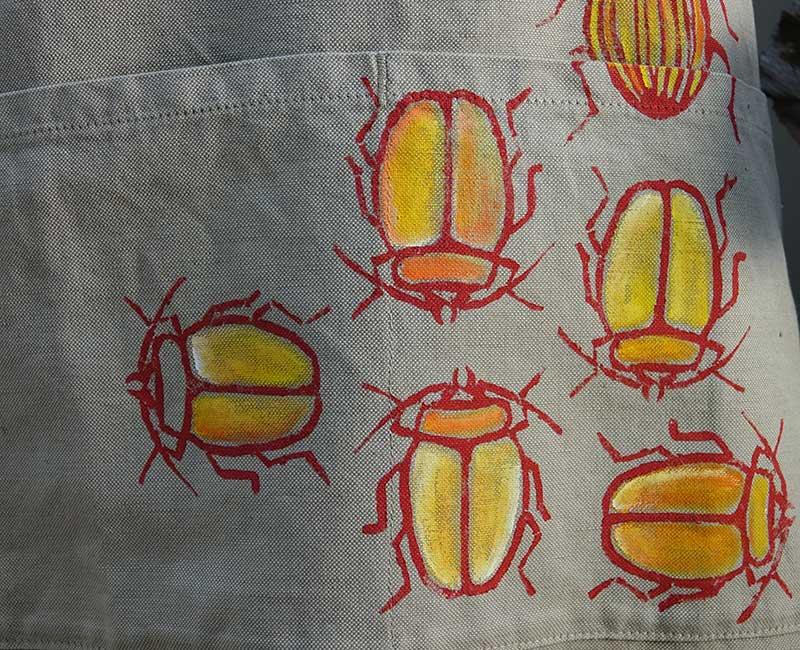 Yellow beetle apron