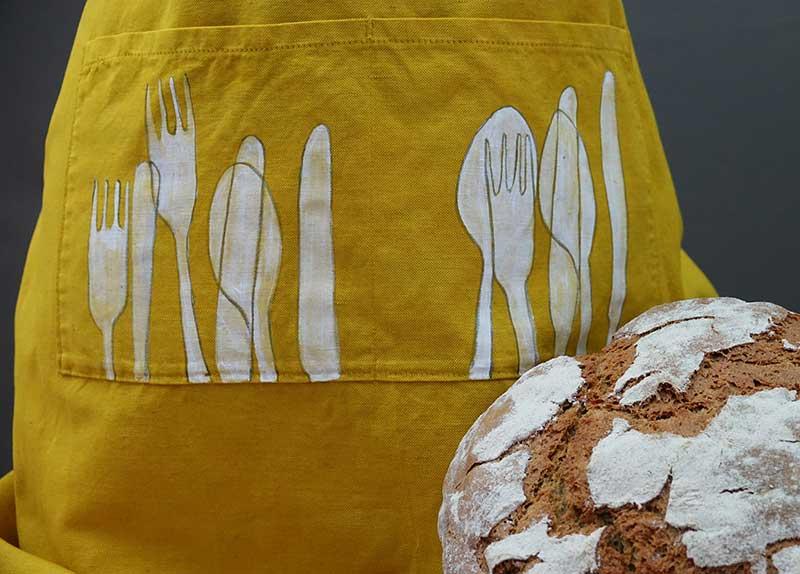 saffron-apron-cutlery